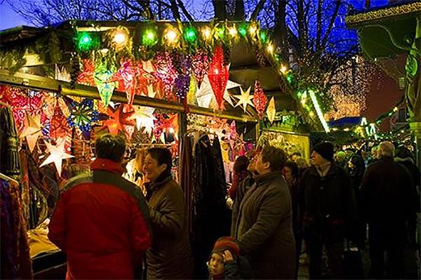 people under Christmas lights