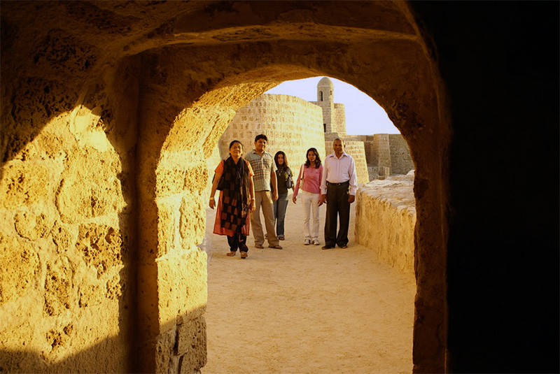 people in an old fort, one of the things to do in Bahrain