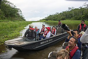 people on skiffs on an Amazon River cruise in Peru