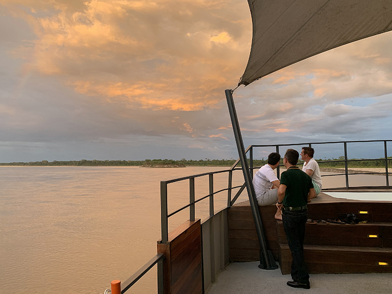 sunset on an Amazon River cruise in Peru